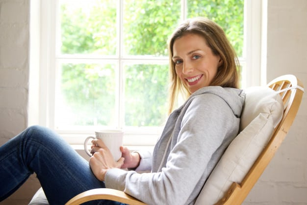 Women enjoying cup of tea in clean and fresh home