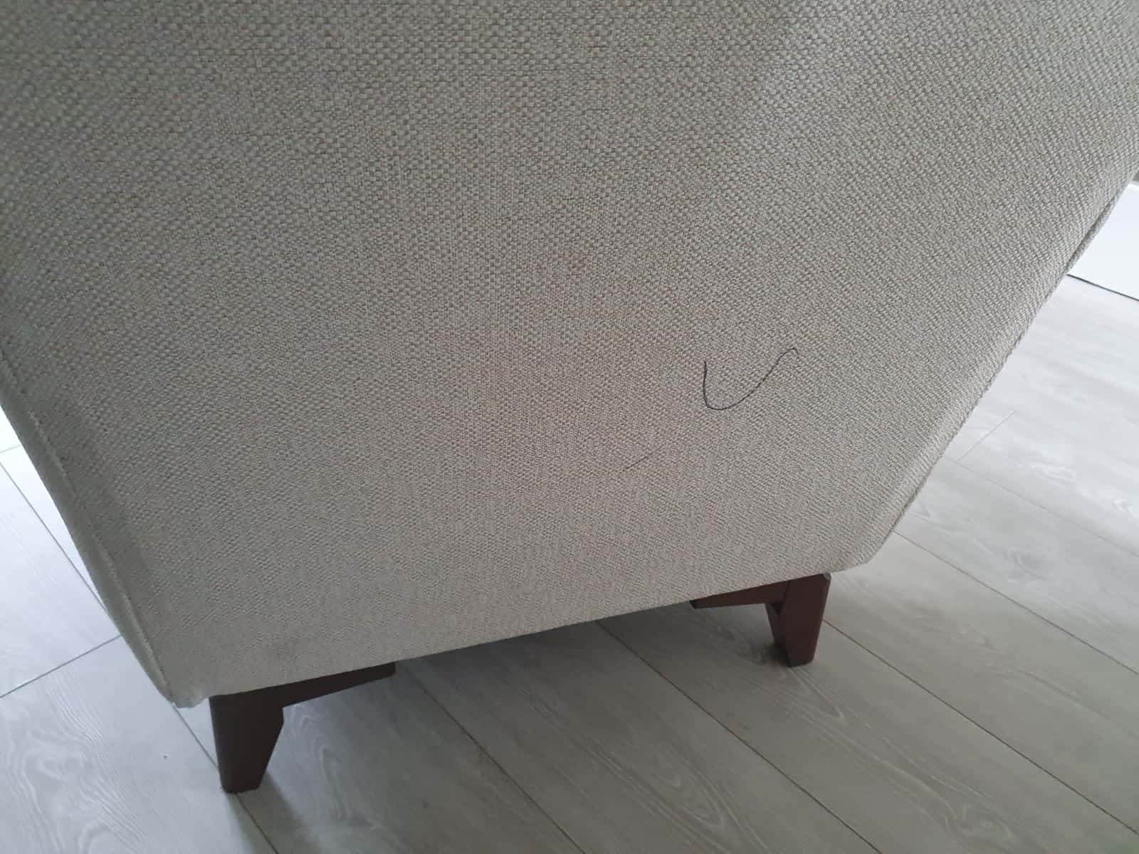 A before image of a sofa that is undergoing upholstery cleaning